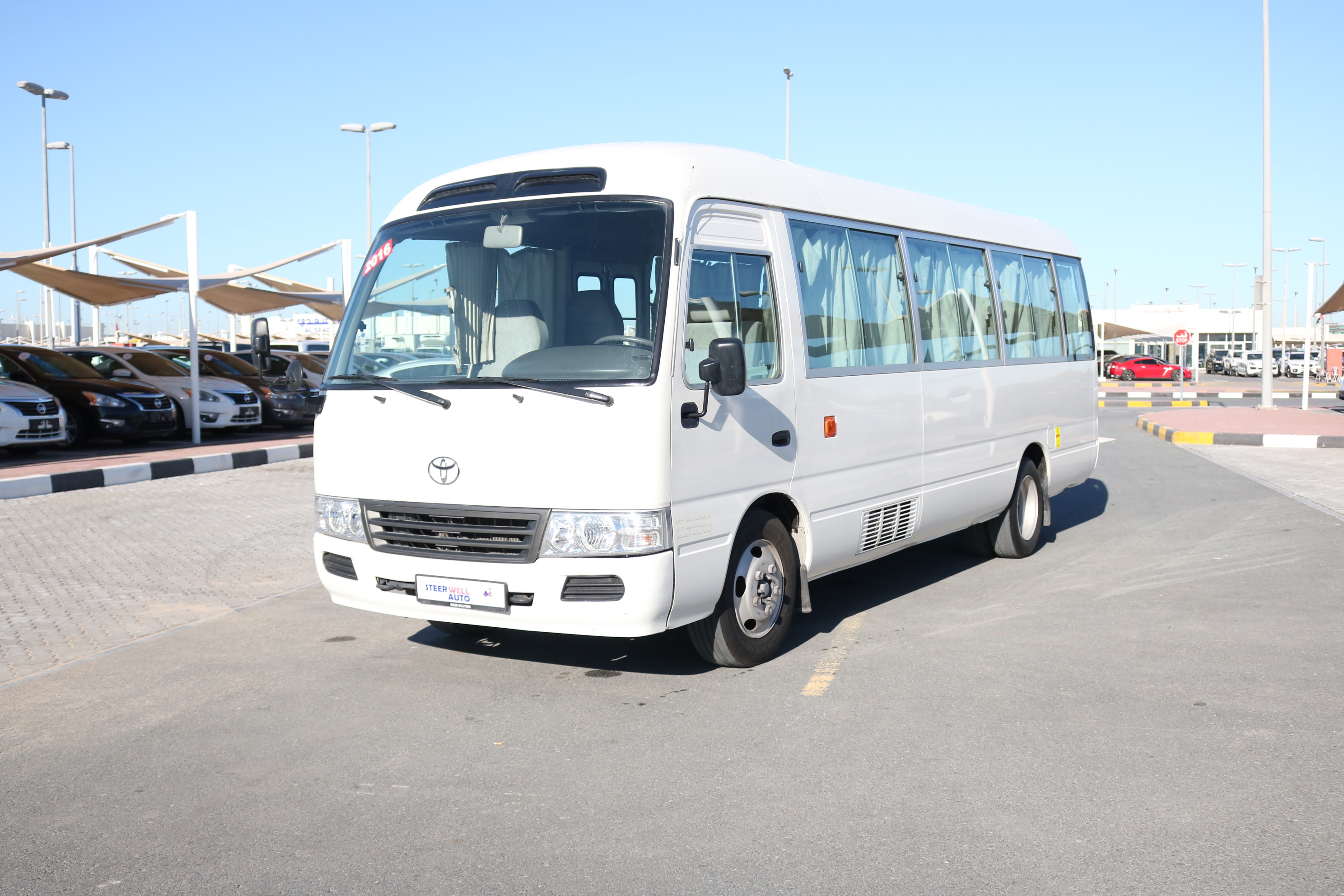 TOYOTA COASTER HI ROOF 30 SEATER